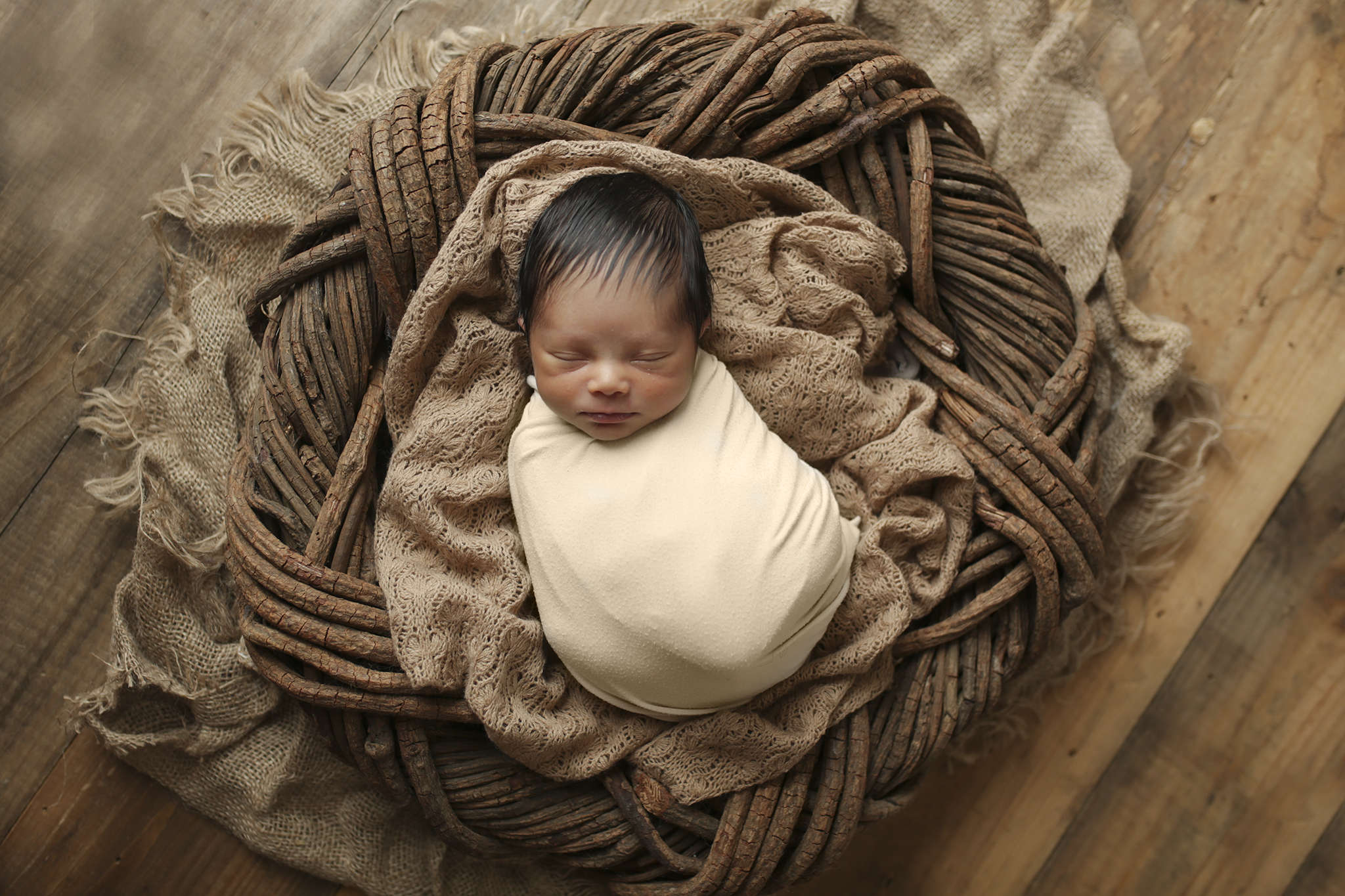 Newborn baby in a posing ring for a beautiful prop shot
